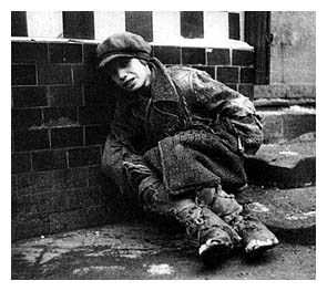 Starving Jewish boy in the Warsaw ghetto.