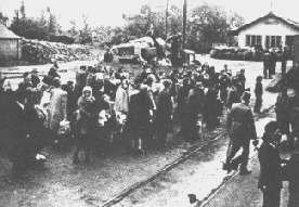 Jews rounded up for deportation by the Hungarian gendarmerie.