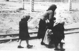 A mother and her children on their way to the gas chambers.